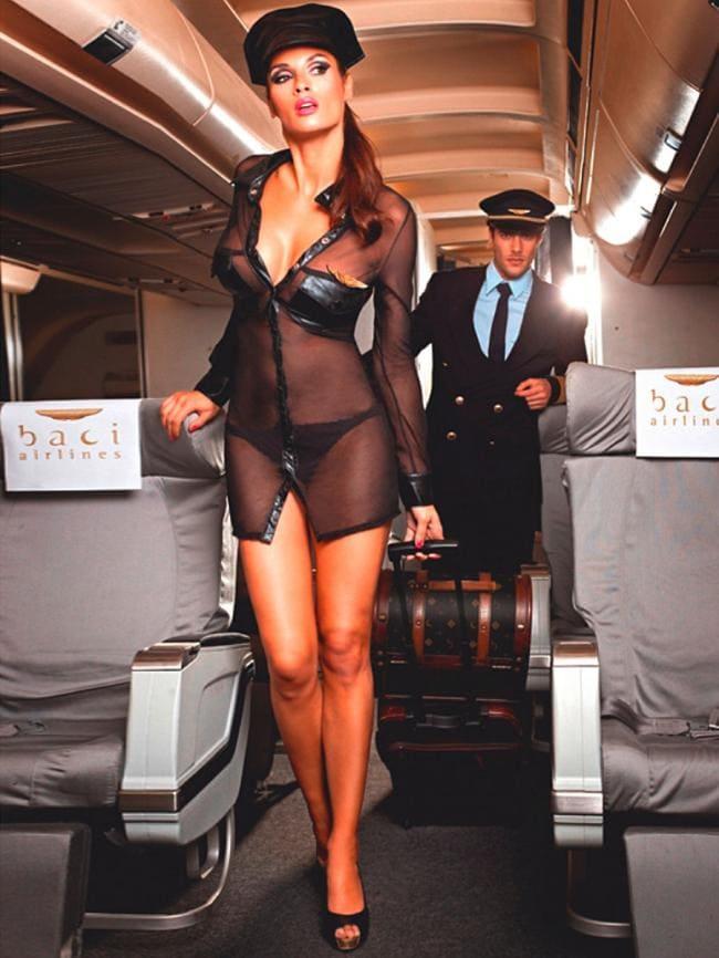 Стюардесса в самолете сексуальная в прозрачной униформе на каблуке